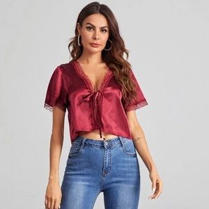 Burgundy crop top with knot and slit.
